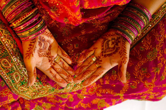 Indian wedding bride getting henna applied.