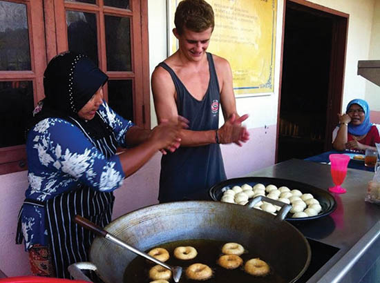 Learning to make doughnuts from local ladies.