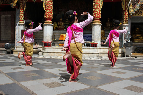 Traditional dancing in front of a shrine at Wat Phra That Doi Suthep - Chiang Mai.